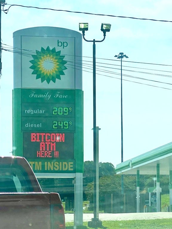 A BP gas station advertises a bitcoin ATM, August 2020