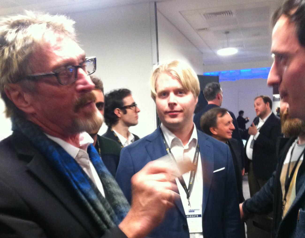 McAfee (left) at the blockchain money conference in London 2016